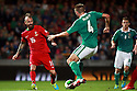 Portugal's Paul Meireles taclkes Northern Ireland's Gareth McAuley during a World Cup Qualifier in Belfast, Friday September 6th, 2013.  Photo/Paul McErlane