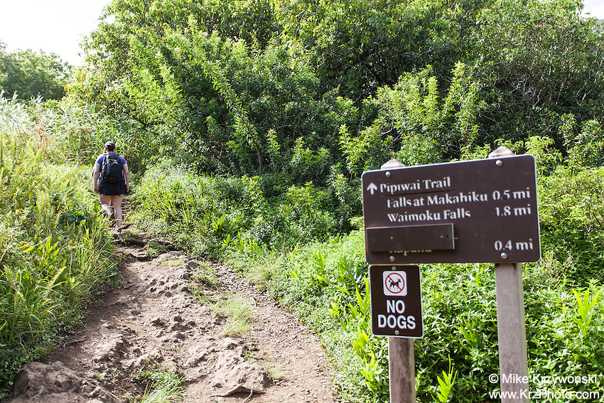Information & directions sign w/ hiker at the  Pipiwai hiking trail, Haleakala National Park, Kipahulu, Maui