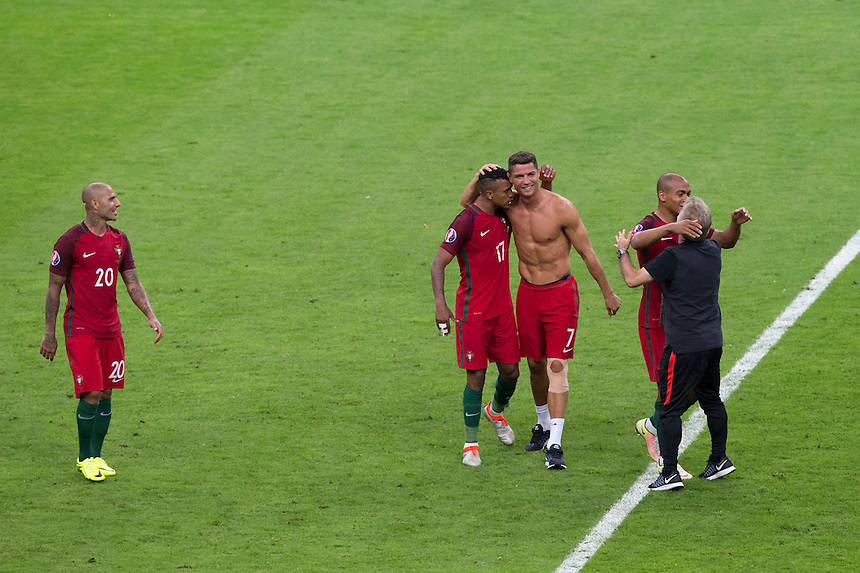 Portugal's Cristiano Ronaldo celebrates with Portugal's Nani after the match<br /> <br /> Photographer Craig Mercer/CameraSport<br /> <br /> International Football - 2016 UEFA European Championship - Final - Portugal v France - Sunday 10th July 2016 - Stade de France - Saint-Denis - Paris - France<br /> <br /> World Copyright &copy; 2016 CameraSport. All rights reserved. 43 Linden Ave. Countesthorpe. Leicester. England. LE8 5PG - Tel: +44 (0) 116 277 4147 - admin@camerasport.com - www.camerasport.com