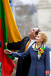 WATERBURY, CT- 15 FEB 2008- 021508JT01-<br /> Waterbury Mayor Michael J. Jarjura and Lithuanian Mayor for the Day Janina Nawarskas look for the rope to raise the Lithuanian flag in front of City Hall during Friday's ceremony to honor Nawarskas and the 90th anniversary of Lithuania's independence.<br /> Josalee Thrift / Republican-American
