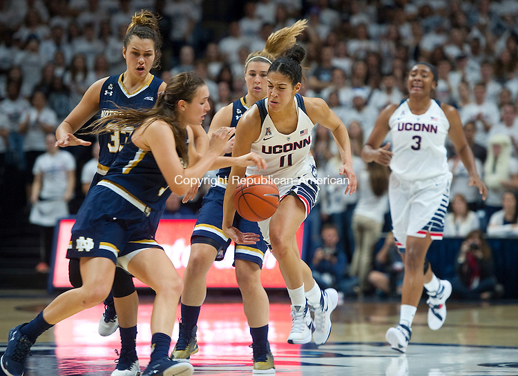 STORRS, CT--- -12015JS12--UConn's Kia Nurse (11) is fouled by Notre Dame's Marina Mabrey (3) during their game Saturday at Gampel Pavilion in Storrs. <br /> Jim Shannon Republican-American