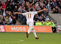 Saturday, 20 October 2012<br /> Pictured: Pablo Hernandez of Swansea celebrating his goal.<br /> Re: Barclays Premier League, Swansea City FC v Wigan Athletic at the Liberty Stadium, south Wales.