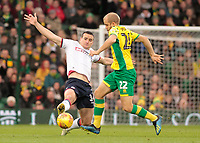 Bolton Wanderers' Jack Hobbs tackles Norwich City's Teemu Pukki<br /> <br /> Photographer David Shipman/CameraSport<br /> <br /> The EFL Sky Bet Championship - Norwich City v Bolton Wanderers - Saturday 8th December 2018 - Carrow Road - Norwich<br /> <br /> World Copyright &copy; 2018 CameraSport. All rights reserved. 43 Linden Ave. Countesthorpe. Leicester. England. LE8 5PG - Tel: +44 (0) 116 277 4147 - admin@camerasport.com - www.camerasport.com