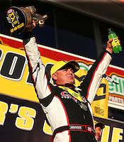 Feb 14, 2016; Pomona, CA, USA; NHRA top fuel driver Steve Torrence celebrates after winning the Winternationals at Auto Club Raceway at Pomona. Mandatory Credit: Mark J. Rebilas-USA TODAY Sports