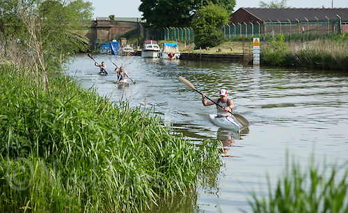26 MAY 2013 - BRIGG, GBR - Competitors head to shore at the end of the kayak leg of the 2013 Brigg Bomber Quadrathlon, a World Quadrathlon Federation World Cup round and the British Championships, held in Brigg in Lincolnshire, Great Britain .(PHOTO (C) 2013 NIGEL FARROW)