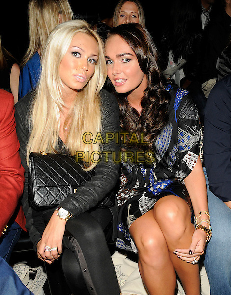 PETRA & TAMARA ECCLESTONE .At the Issa Show, London Fashion Week Day 3, Somerset House, London, England, UK,.September 20th 2009..half length black chanel bag sisters family gold wrist watch blue print dress leather jacket.CAP/CAN.©Can Nguyen/Capital Pictures.