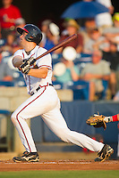 Jace Whitmer #40 of the Rome Braves follows through on his swing against the Greenville Drive at State Mutual Stadium July 24, 2010, in Rome, Georgia.  Photo by Brian Westerholt / Four Seam Images