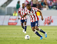 CARSON, CA - June 16, 2012: Chivas USA midfielder Oswaldo Minda (8) during the Chivas USA vs Real Salt Lake match at the Home Depot Center in Carson, California. Final score Real Salt Lake 3, Chivas USA 0.