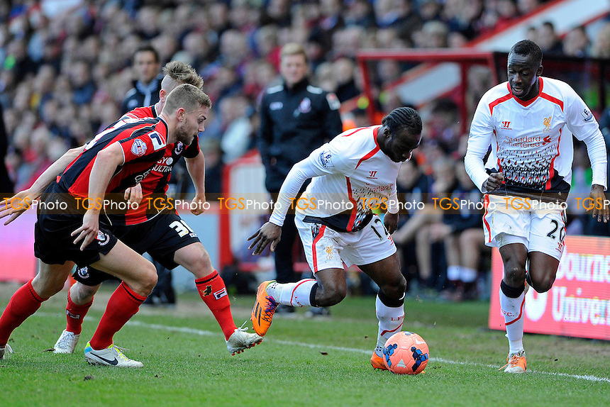 Victor Moses of Liverpool evades Simon Francis of AFC Bournemouth - AFC Bournemouth vs Liverpool - FA Cup 4th Round Football at the Goldsands Stadium, Bournemouth, Dorset - 25/01/14 - MANDATORY CREDIT: Denis Murphy/TGSPHOTO - Self billing applies where appropriate - 0845 094 6026 - contact@tgsphoto.co.uk - NO UNPAID USE
