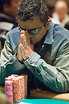 Joseph Hachem reacts as he trys to figure out if he wants to make a call.  He did not, he folded.