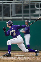 Washington Huskies designated hitter Branden Berry (36) follows through on his swing during the NCAA baseball game against the Michigan Wolverines on February 16, 2014 at Bobcat Ballpark in San Marcos, Texas. The game went eight innings, before travel curfew ended the contest in a 7-7 tie. (Andrew Woolley/Four Seam Images)