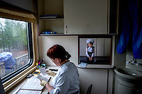 Liza Bazhanova (8) waits for the pathology results in the laboratory aboard the Matvei Mudrov train. Even at her age, she complains about the lack of decent healthcare in her home village of Olekma.<br /> <br /> The Matvei Mudrov train is a medical train operated by Russian Railways along the course of the Baikal Amur Magistral (Baikal-Amur Mainline, or BAM) railway line. Named after a famous 19th century Russian physician, the train employs around 15 doctors who make about 10 trips a year, each lasting two weeks. Along the way they deliver essential medical services to people living in remote villages along the 4,324 km long BAM railway. Though not equipped to carry out surgical procedures the train has heart monitors, ultrasound and x-ray machines to deliver diagnosis.