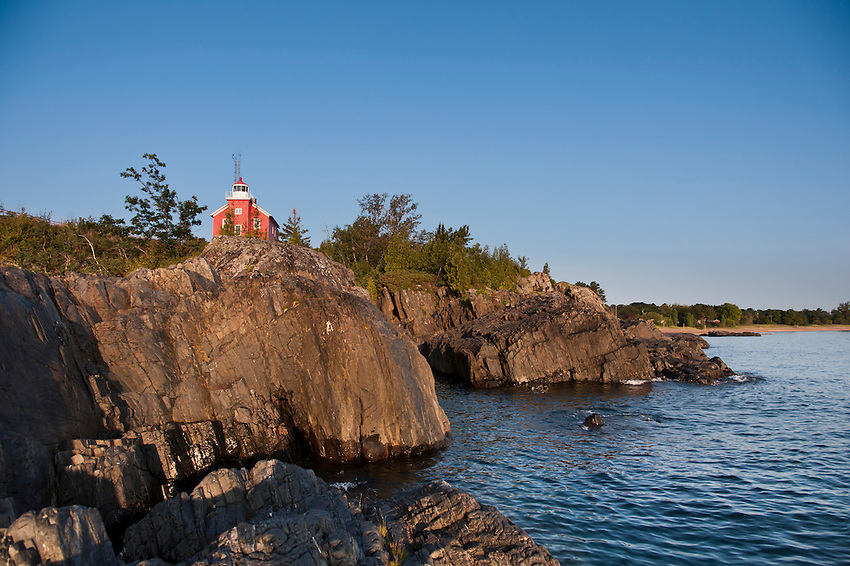 The Marquette Lighthouse sits atop a rugged rock headland on Lake Superior in Marquette, Michigan.