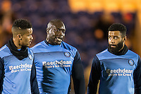 Adebayo Akinfenwa of Wycombe Wanderers chats to teammates Alex Jakubiak (right) & Paris Cowan-Hall (left) during the Sky Bet League 2 match between Colchester United and Wycombe Wanderers at the Weston Homes Community Stadium, Colchester, England on 21 February 2017. Photo by Andy Rowland / PRiME Media Images.