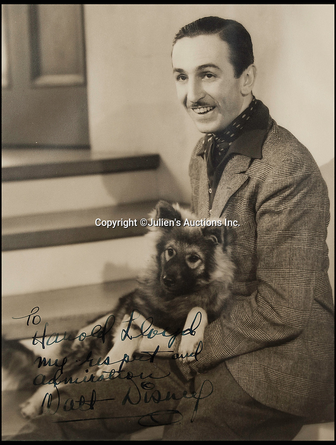 BNPS.co.uk (01202 558833)<br /> Pic: JuliensAuctions/BNPS<br /> <br /> Even cartoon pioneer Walt Disney sent one in.<br /> <br /> The Rogues Gallery - Unique Who's who from the halcyon days of Hollywood collected by one of their own, comedian Harold Lloyd.<br /> <br /> The silent movie actor asked his silver screen chums to send him their best loved publicity shots one Xmas, so he could create a 'Rogues Gallery' at his Hollywood mansion.<br /> <br /> The unique collection reveals tinsel town as it preferred to see itself in its most glamourous era between the wars.
