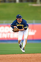 Michigan Wolverines shortstop Michael Brdar (9) throws to first base during the second game of a doubleheader against the Canisius College Golden Griffins on February 20, 2016 at Tradition Field in St. Lucie, Florida.  Michigan defeated Canisius 3-0.  (Mike Janes/Four Seam Images)