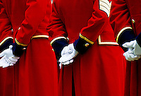 Details of traditional red coat uniforms of Chelsea Pensioners