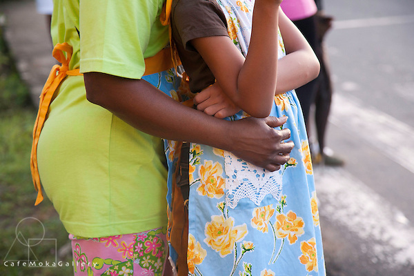 Mother and daughter embrace - patterned fabric and pastel colours