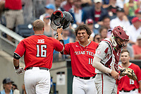 Texas Tech Red Raiders first baseman Cameron Warren (11) celebrates with teammate Josh Jung (16) during Game 5 of the NCAA College World Series against the Arkansas Razorbacks on June 17, 2019 at TD Ameritrade Park in Omaha, Nebraska. Texas Tech defeated Arkansas 5-4. (Andrew Woolley/Four Seam Images)