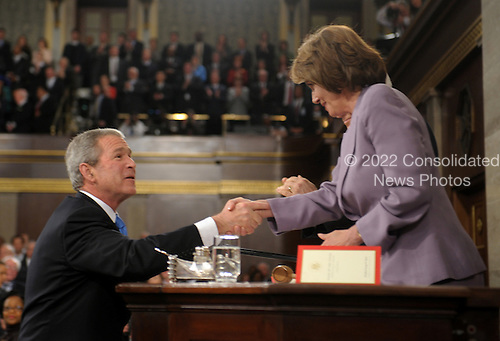 US President George W. Bush shakes hands with Speaker of the House Nanc Pelosi before he delivers the final State of the Union address of his presidency at the US Capitol in Washington 28 January 2008.   .Credit: Tim Sloan - Pool via CNP