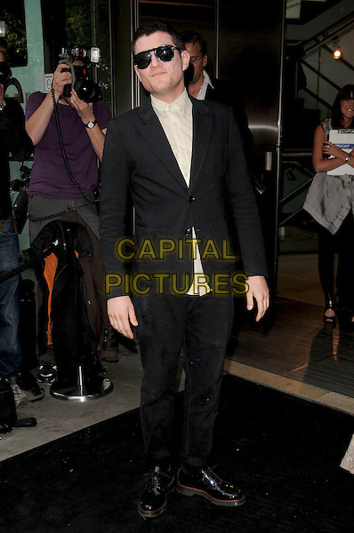 """MATHEW HORNE .Opening Night of the """"Ballets Russes"""" season at the Sadlers Wells Theatre, London, England. .June 16th, 2009 .full length black suit matthew mat sunglasses shades .CAP/CAS.©Bob Cass/Capital Pictures."""