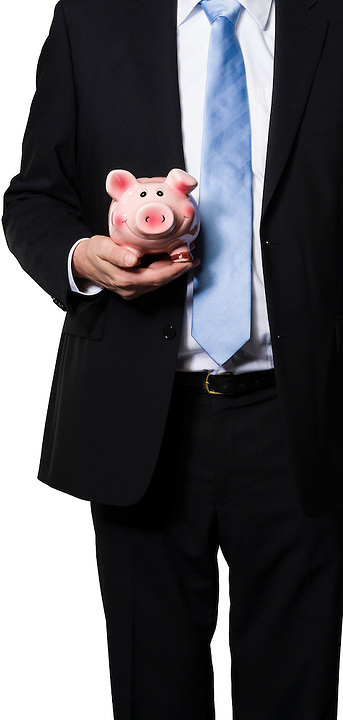 Executive showing a coin box as a metaphor for savings or as a metaphor for a modern farmer or a financial manager