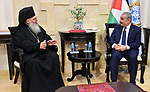Palestinian Prime Minister Mohammad Ishtayeh, Receive an invitation to celebrate Christmas and Midnight Mass, in the West Bank city of Ramallah, on December 30, 2019. Photo by Prime Minister Office