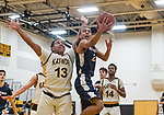 WATERBURY, CT. 09 January 2020-010920BS218 - Wolcott Tech's Anthony Petersen (2), right, drives to the basket against Kaynor Tech's Jared Gomez (13), during a Boy Basketball game between Wolcott Tech and Kaynor Tech at Kaynor Tech in Waterbury on Thursday. Bill Shettle Republican-American