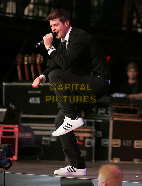 ROBIN THICKE.Performing live on stage at The 10th Annual KIIS FM Wango Tango 2007 held at Verizon Wireless Ampitheatre in Irvine, California, USA, May 12 2007..full length concert music gig black top jumper tie white shirt collar dancing.CAP/DVS.©Debbie VanStory/Capital Pictures