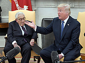 United States President Donald J. Trump meets former US Secretary of State Dr. Henry Kissinger in the Oval Office of the White House in Washington, DC on Tuesday, October 10, 2017.  During the photo-op the President took some questions from reporters.<br /> Credit: Ron Sachs / CNP