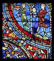 A courtesan and a servant carry food and drink to the table, from The Feast in the Brothel, from the Parable of the Prodigal Son stained glass window, in the north transept of Chartres Cathedral, Eure-et-Loir, France. This window follows the parable as told by St Luke in his gospel. It is thought to have been donated by courtesans, who feature in 11 of the 30 sections. Chartres cathedral was built 1194-1250 and is a fine example of Gothic architecture. Most of its windows date from 1205-40 although a few earlier 12th century examples are also intact. It was declared a UNESCO World Heritage Site in 1979. Picture by Manuel Cohen