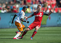 28 July 2012: Toronto FC defender Richard Eckersley #27 and Houston Dynamo midfielder Boniek Garcia #27 in action during an MLS game between Toronto FC and the Houston Dynamo at BMO Field in Toronto,Ontario Canada...
