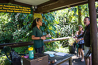 People in conversation at the entrance to Hawaii Tropical Botanical Garden in Papa'ikou, north of Hilo, Big Island of Hawaiʻi.