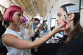 London, UK. 13 September 2014. A model in makeup before the show. Backstage at the Julien Macdonald show at London Fashion Week SS15 at the Royal Opera House in London, England. Photo: CatwalkFashion/Alamy Live News
