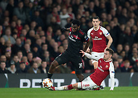 Aaron Ramsey of Arsenal tackles Franck Kessie of AC Milan during the UEFA Europa League round of 16 2nd leg match between Arsenal and AC Milan at the Emirates Stadium, London, England on 15 March 2018. Photo by Vince  Mignott / PRiME Media Images.