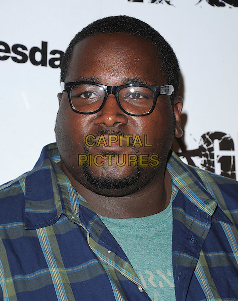Quinton Aaron .attends the official launch party for 'Rage' in ChinaTown, Los Angeles, California, USA, September 30th 2011..portrait headshot  glasses goatee green blue plaid shirt                                                                                .CAP/RKE/DVS.©DVS/RockinExposures/Capital Pictures.