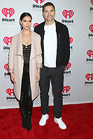 LOS ANGELES - JAN 17:  Roselyn Sanchez and Eric Winter at the 2020 iHeartRadio Podcast Awards at the iHeart Theater on January 17, 2020 in Burbank, CA