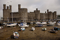Harbor at low tide around Caernarfon Castle, North Wales