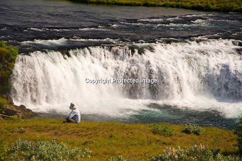Enjoying Spray from Waterfall near Selfoss in South Iceland
