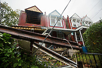 The winds of Hurricane Sandy blew out the front second floor windows from a vacant house on the 6300 block of Cherokee Street in Germantown.