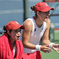 STANFORD, CA - April 1, 2011:  Hilary Barte and Nicole Gibbs cheer on teammates during Stanford's 6-1 victory over Arizona State at Stanford, California on April 1, 2011.
