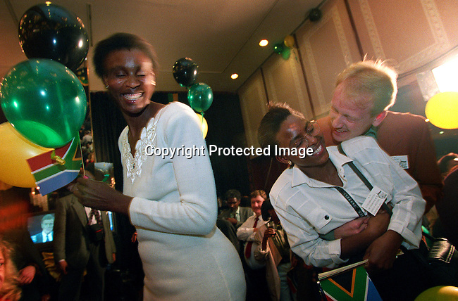 ANC supporters celebrate the election victory in the first democratic election on April 27 1994 in South Africa. They celebrated at Carlton Hotel in central Johannesburg, South Africa. President Nelson Mandela was elected president for one 5-year term and retired in 1999. Thabo Mbeki, the current President of South Africa, was chosen to take his job.