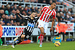 Remy Cabella of Newcastle United struggles to keep up with Stoke's Steven N'Zonzi - Newcastle United vs. Stoke City - Barclay's Premier League - St James' Park - Newcastle - 08/02/2015 Pic Philip Oldham/Sportimage