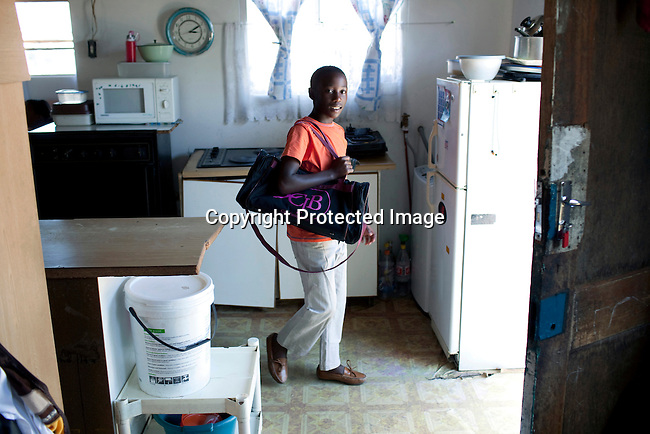 CAPE TOWN, SOUTH AFRICA - MARCH 15: Sikhumbuzo Hlahleni, age 15,  walks from home to take a taxi to train at Cape Town City Ballet's youth company on March 15, 2010 in Cape Town, South Africa. He trains in Cape Town every Saturday. He also trains a few days week at home in Khayelitsha, a poor township outside Cape Town. He has to change taxi three times to get to the school.  (Photo by Per-Anders Pettersson).