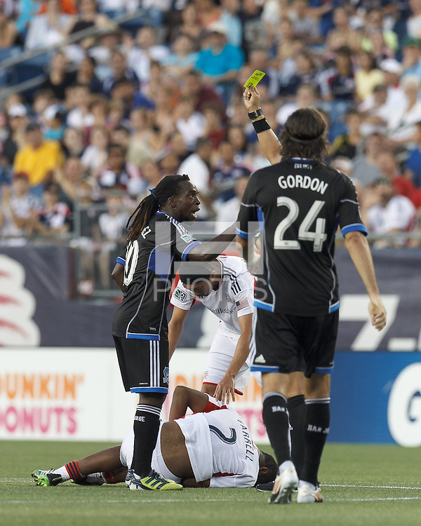 Yellow Card: San Jose Earthquakes midfielder Walter Martinez (10) from referee Jose Carlos Rivero. In a Major League Soccer (MLS) match, the New England Revolution (white) defeated San Jose Earthquakes (black), 2-0, at Gillette Stadium on July 6, 2013.