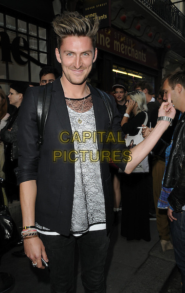 HENRY HOLLAND .At the opening of the Acne London Studio, Dover Street, London, England, UK, July 15th 2010..half length lace sheer t-shirt see thru through jacket black blazer white arm finger .CAP/CAN.©Can Nguyen/Capital Pictures.