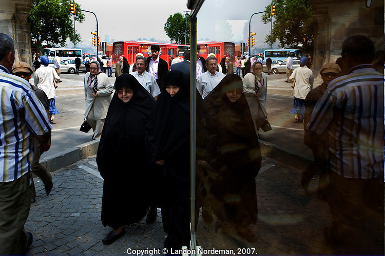 ISTANBUL - MAY 25, 2007:   Women walk by the ferry terminals in Istanbul, Turkey. Photo by Landon Nordeman.