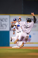 Chattanooga Lookouts second baseman Levi Michael (9) turns a double play as Austin Nola (36) slides in during a game against the Jacksonville Suns on April 30, 2015 at AT&T Field in Chattanooga, Tennessee.  Jacksonville defeated Chattanooga 6-4.  (Mike Janes/Four Seam Images)