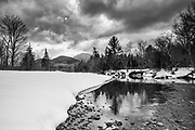 Black & White of the Swift River during the winter months in Albany, New Hampshire. Mount Passaconaway is off in the distance.