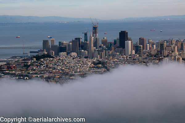 aerial photograph San Francisco skyline behind layer of fog, California